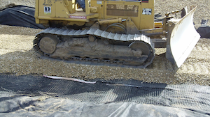 A mechanically stabilized layer (MSL) using Tensar's TriAx Geogrid was used to produce a stable and unyielding platform for the contractor to build upon. After the first layer of geogrid and rock, the operators were able to drive their equipment completely across the affected areas.
