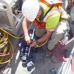 Engineer attaching sonar to pipeline