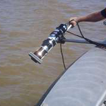 Close-up of engineer deploying sonar from side of boat