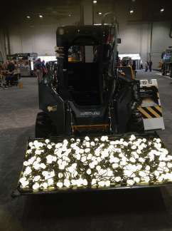 "John Deere Forestry and Construction filled the bucket of the machines in one of its new E Series with light bulbs signifying the ""bright ideas"" used to develop this series and its new 644K Hybrid wheel loader"