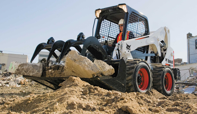 Bobcat S650 skid steer with industrial grapple