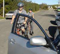 cyclist car door