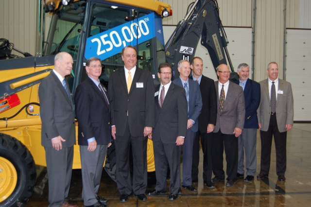 Members of the Deere and NPL teams at the 250,000th backhoe event. At left, Mike Mack, Deere Construction & Forestry president, and Jim Kane, president and CEO of NPL Construction.