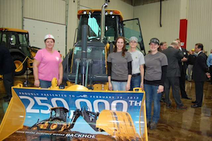 John Deere production workers at the 250,000th backhoe event.