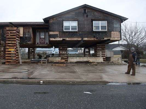 Steven Hauck, owner of SJ Hauck House Movers, looks at one of the many New Jersey homes damaged by Hurricane Sandy. (Credit: Denise Henhoeffer, Courier-Post, Cherry Hill, N.J.)