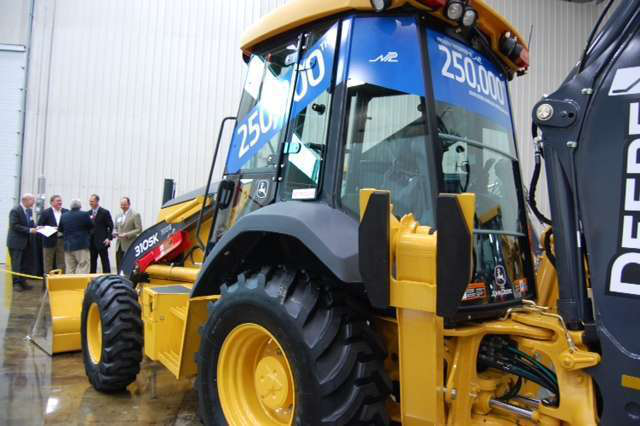 The 250,000 John Deere backhoe is the 310SK pictured. It was presented to NPL Construction who primarily buys its equipment from Deere.