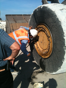At a minimum you or your operators should check your earthmover tires' air pressure once a week. Daily is better.