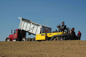 The Volvo PF2181 has an 8-foot screed, which transports with no permit, compared to 10-foot units.