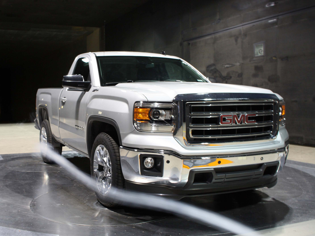 The 2014 GMC Sierra's new front air dam directs air out and around the truck's tires, benefitting the truck's aerodynamic efficiency.