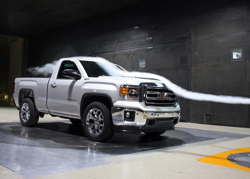 A 2014 GMC Sierra pickup undergoes testing in the GM Aerodynamics testing.