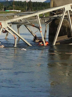 A man stands outside his truck in the Skagit River after the I-5 bridge collapse. (Photo: KING 5 News / Twitter)