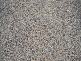 A close-up shows the highway's three-course surface treatment that included the use of CRS-2P,  a cationic rapid setting type of emulsified asphalt modified with the addition of polymers, and expanded clay lightweight aggregate. (Photo: Big River Industries)