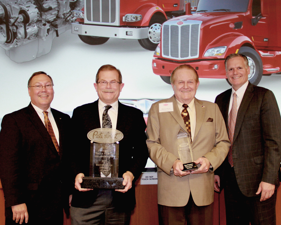 Peterbilt Motors Company presented Rush Peterbilt Truck Center – Nashville the award for Medium Duty Dealer of the Year. (Pictured, left to right: Robert Woodall, Peterbilt director of sales and marketing; Rusty Rush, Rush Enterprise; Marvin Rush, Rush Enterprise; and Bill Kozek, Peterbilt general manager and PACCAR vice president.