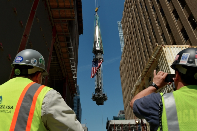 spire hoisted atop WTC