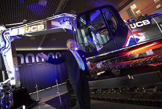 JCB Chairman Sir Anthony Bamford stands by the company's one millionth machine.