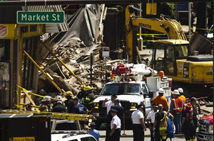Workers search through the rubble of a collapsed building in Philadelphia. Credit: Reuters/Eduardo Munoz