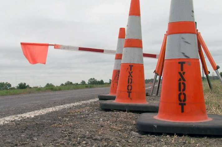 An Automated Flagger Assistance Device is seen in the lowered position. The Texas DOT has begun using the devices to keep flaggers at a safe distance.