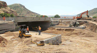 UDOT crews work on an I-84 overpass, using geosynthetic reinforcement and soil integration in place of steel pylons and concrete. (Photo: Jeffrey D. Allred, Deseret News)