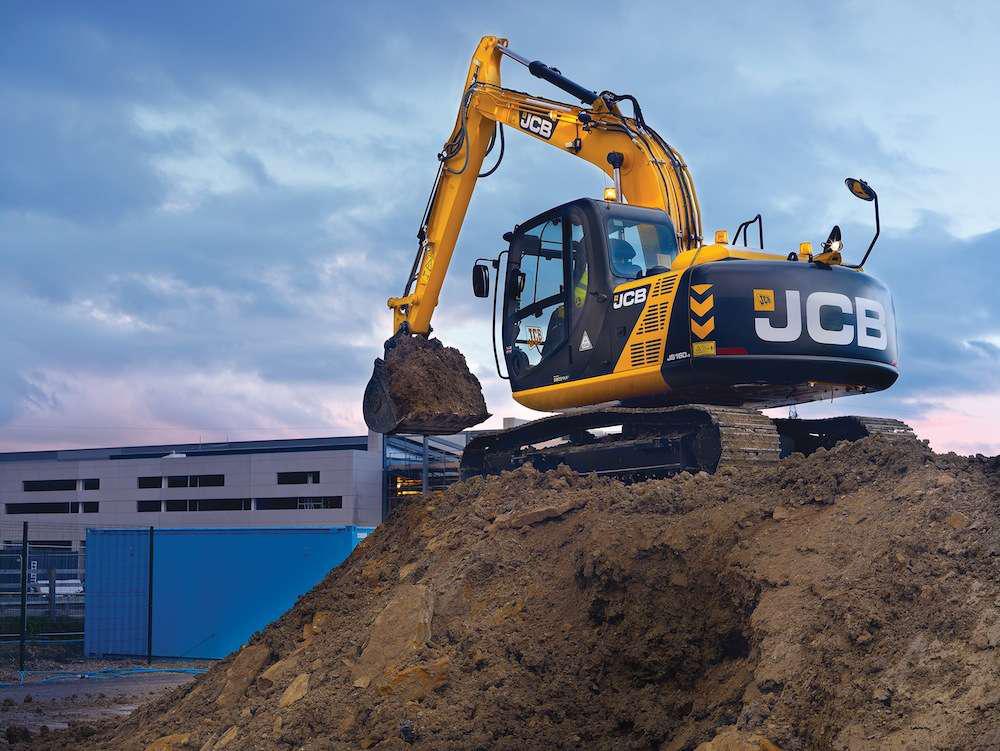 JCB JS160 compact excavator on pile