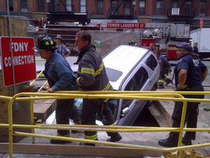 The SUV that crashed into the Second Avenue Subway construction site is seen at rest in a ditch. Credit: NBC 4 New York