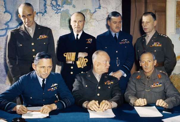 General Eisenhower, seated center, with his staff of Allied military leaders during WWII. Credit: History.com