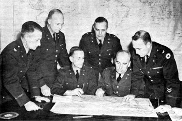 Eisenhower, standing second from left, during war planning in March of 1942.
