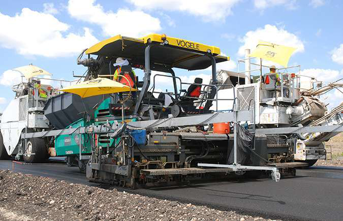 On S.H. 130, Central Texas Toll Road, Roadtec MTVs (Shuttle Buggies) feed pavers with skis with sensors providing input for automatic-leveling controls.