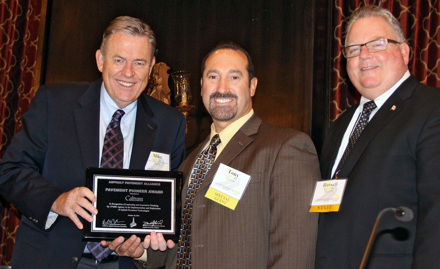 National Asphalt Pavement Association President Mike Acott (left) and California Asphalt Pavement Association Executive Director Russell Snyder (right) present the Pavement Pioneer Award to Caltrans Maintenance Chief Tony Tavares. (Photo courtesy of APA)