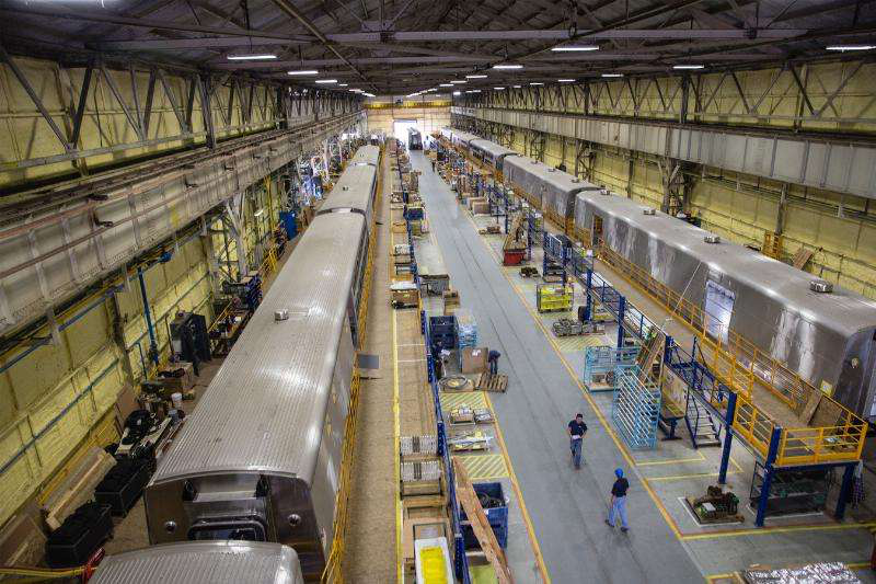 Amtrak employees work to manufacture and assemble the company's new long distance cars at the CAF USA facility in Elmira, New York. (Photo: PRNewsFoto/Amtrak)