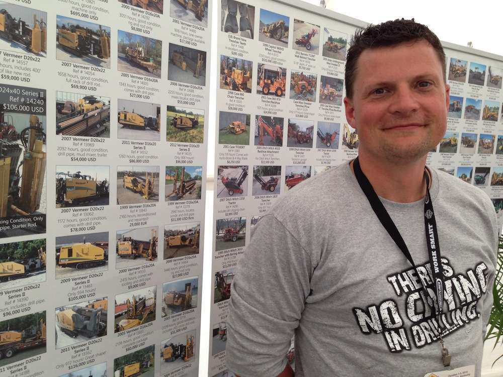 At ICUEE 2013, Bob Martin, HDD Broker's general manager, stands in front o a listing of used drills available from his company.
