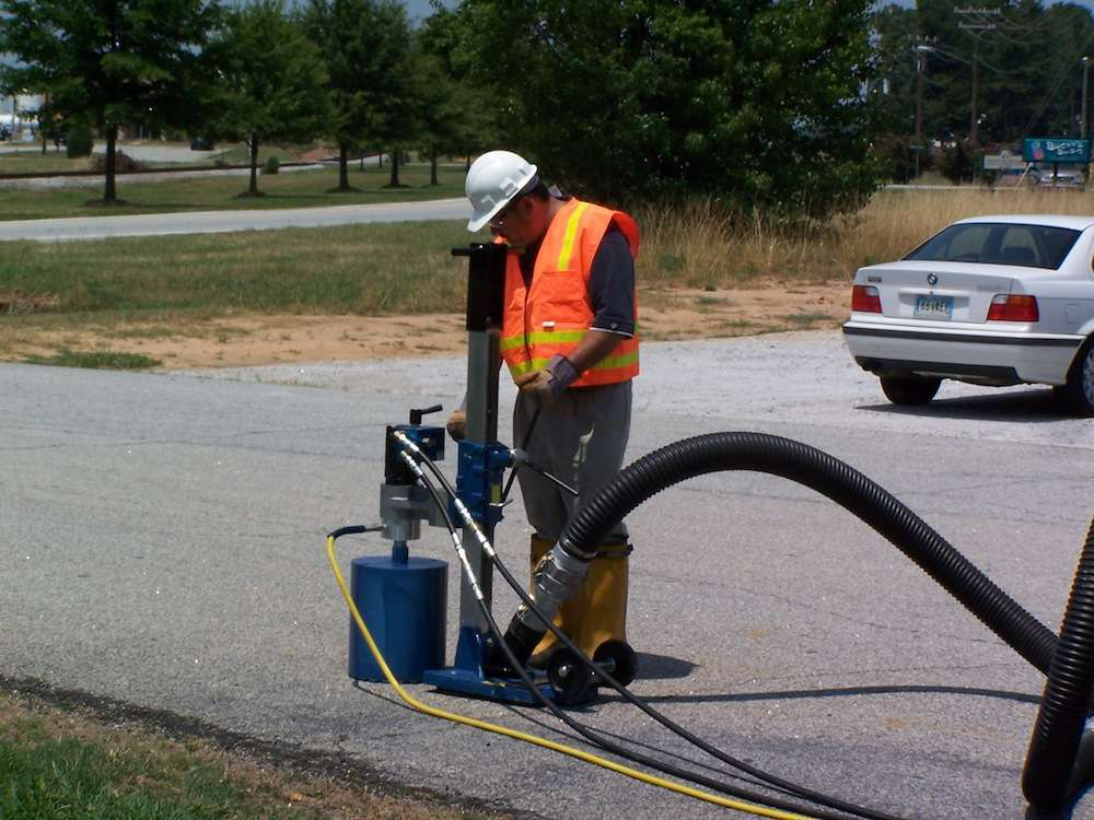 The Mini Core Drill, opens up holes in pavement and runs off the vacuum excavator's hydraulic power.