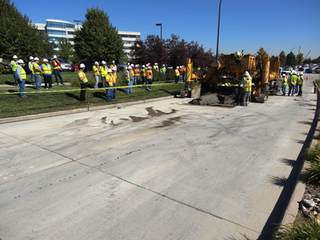 Workers pour concrete on a roadway in Highlands Ranch, Colorado, for one of the largest concrete pavement preservation projects. (Photo: )