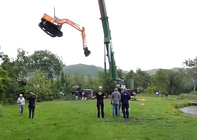 crane rescues excavator