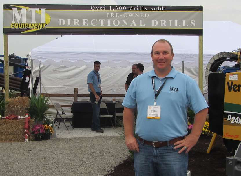 Kevin Smith, MTI's general manager, in front of the company's booth at ICUEE 2013.