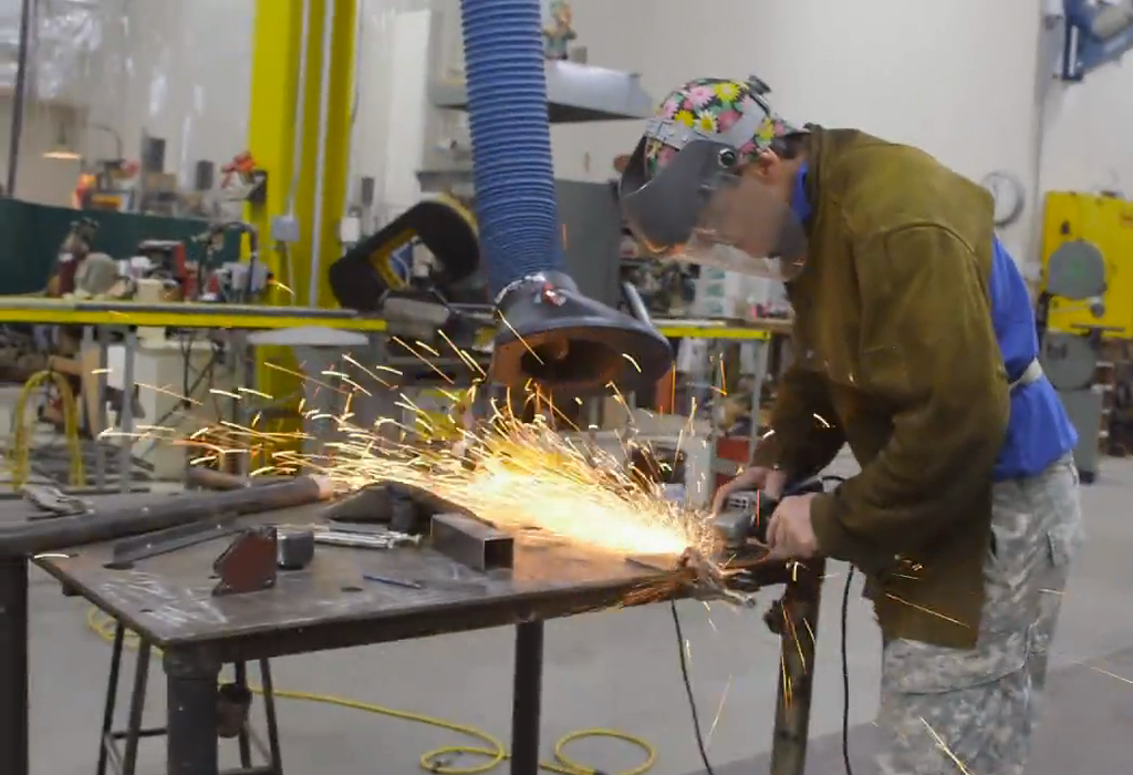 A welder working inside the Macy's Thanksgiving Day Parade studio.