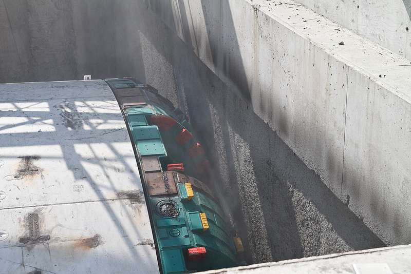 Bertha isn't exactly incapable of going through solid objects. Here, she starts her 2-mile journey by chewing through a wall in July. Credit: WSDOT Flickr