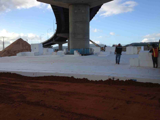 Engineers specified EPS geofoam as a lightweight sub-base for highway lanes in Trinidad built over an existing pier pile cap. (Photo courtesy of Insulufoam)