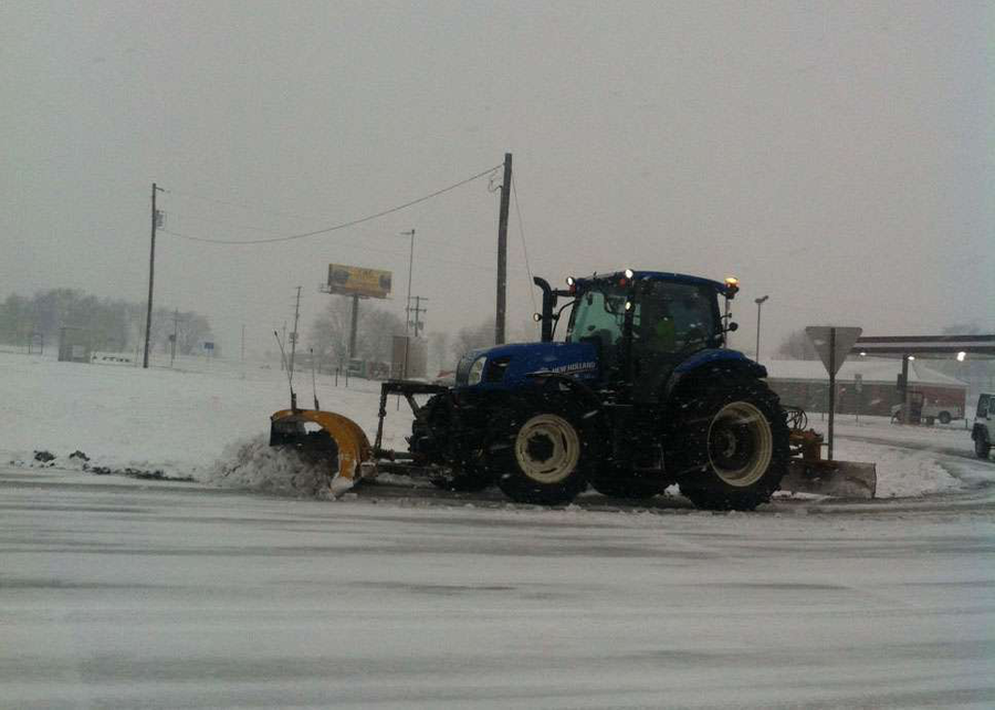 A tractor clears the ramp on Exit 125 on northbound Interstate 55 in Perry County, Missouri, on January 5, 2014, during the Midwest storms that brought temperatures down to well below zero.  (Photo: MoDOT)