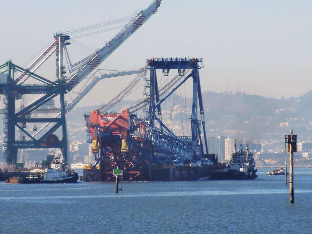 The Left Coast Lifter leaves the Port of Oakland. Credit: @NewNYBridge Twitter account.