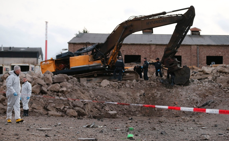 Police examine a construction disposal site where a World War II bomb exploded in Euskirchen, Germany. Credit: Frank Augstein/AP