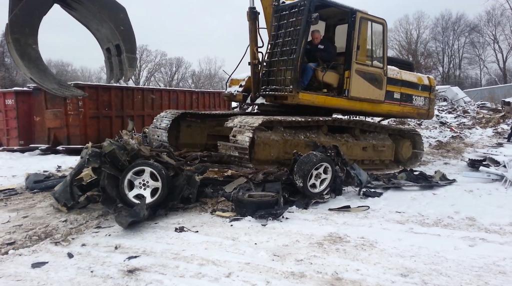 Excavator destroys Dodge Viper