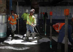 Workers pour concrete at the Transbay Transit Center construction site last year. Credit: San Francisco Chronicle