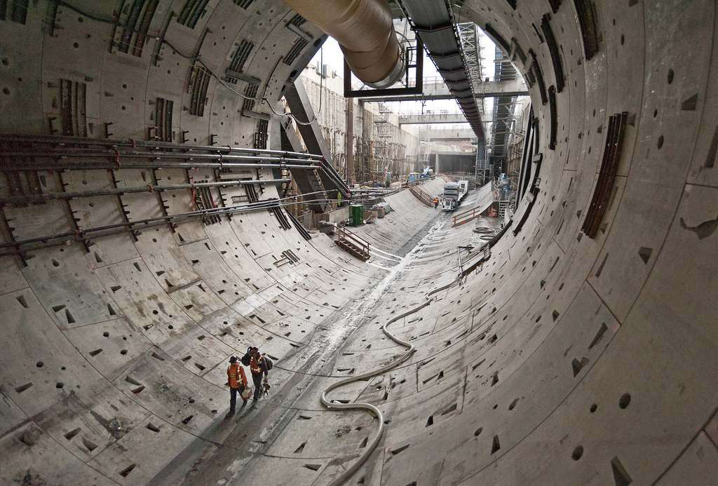 What Big Bertha leaves behind. Two workers walk through the first rings of tunnel dug by Big Bertha in October.