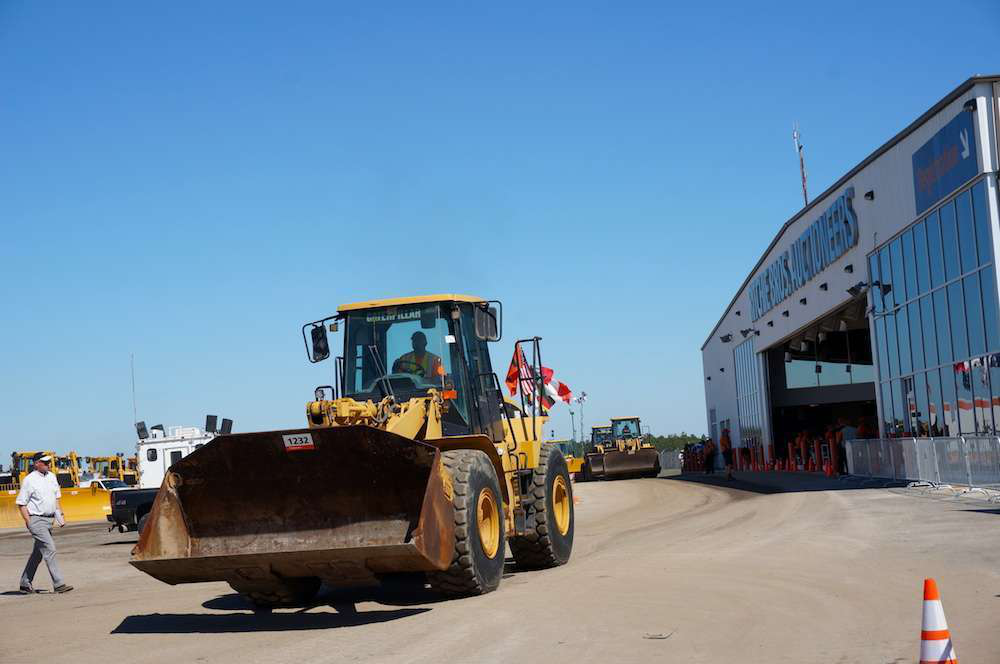 A wheel loader is driven away from the auction ramp during the 2014 Ritchie Bros. Orlando auction.