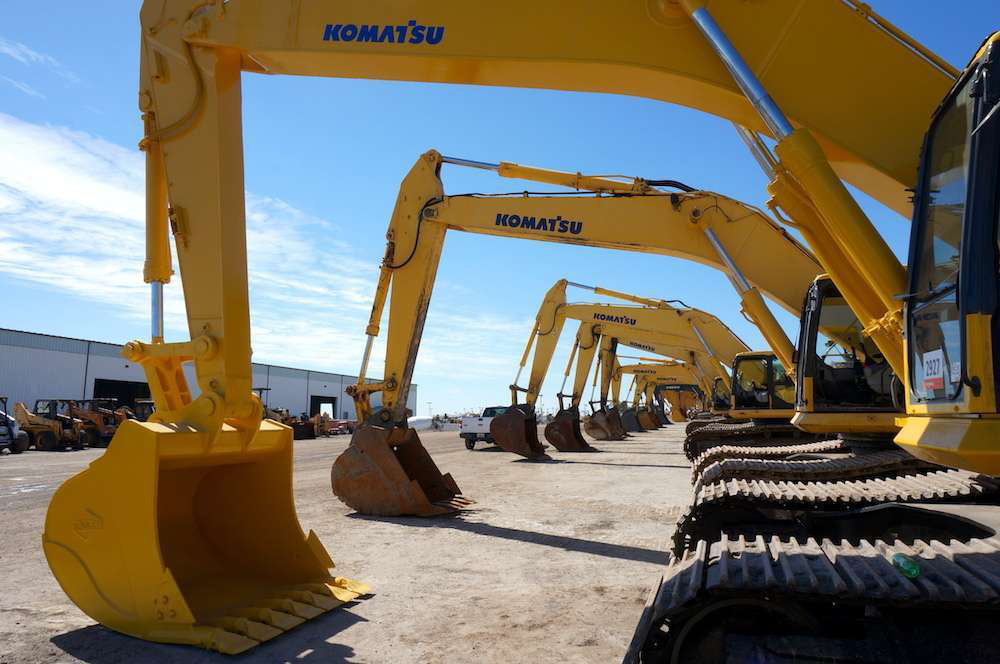 A row of excavators at the Ritchie Bros. Orlando auction lot.