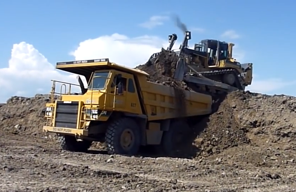 Dozer loads rock truck