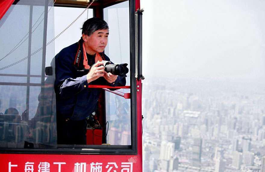 Crane operator Wei Gensheng shooting from his perch high above Shanghai.
