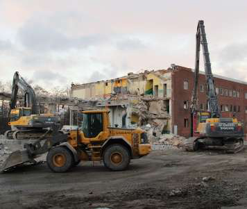 A Volvo L90F wheel loader scoops up debris during the demolition of a 175-year-old Volvo CE plant.