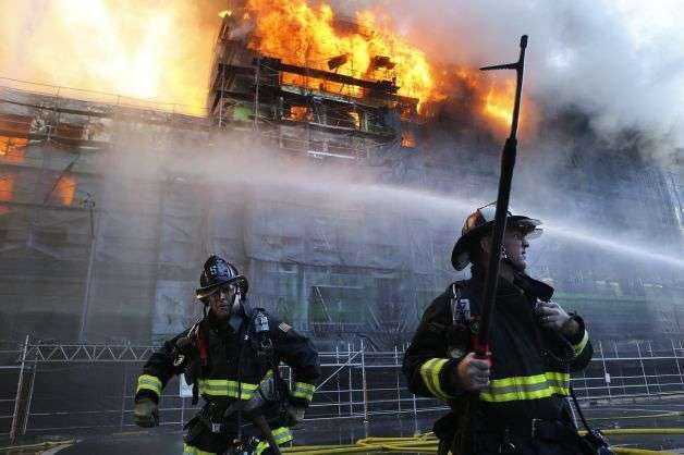 San Francisco firefighters battling back a massive five-alarm blaze in Mission Bay. Credit: Michael Macor, The San Francisco Chronicle