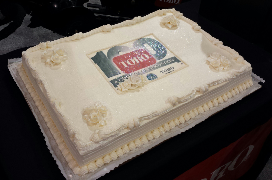 The Toro Co. celebrates its upcoming 100th birthday at ConExpo-Con/Agg 2014 in Las Vegas with a cake to share. (Photo courtesy of Brandon Jaynes/Performance Marketing, the public relations agency representing The Toro Co.)
